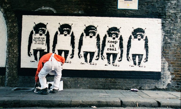 Banksy's a genius' … the artist in an image from Banksy Captured. Photograph: Steve Lazaride